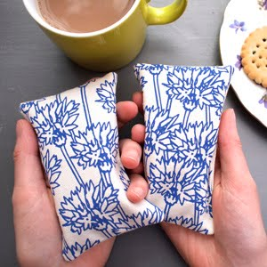 https://www.etsy.com/uk/listing/203835909/hand-warmers-cornflower-print?ref=shop_home_active_48